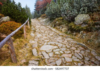 Trail in autumn scenery, stone path with simple wooden balustrade high in the mountains, Poland, Europe