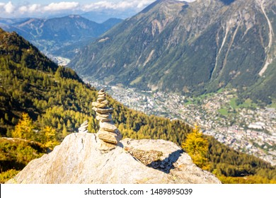 Trail blazing cairn rocks stones sign Chamonix valley town mountain route above landscape view. French Alps tourism  Europe travel.