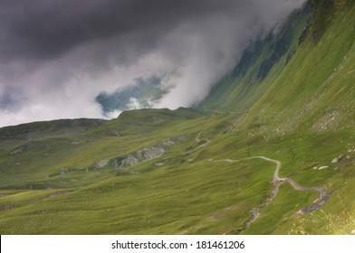 Trail with dark clouds - The Alps, Montafon, Austria