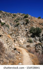 Trail leading through a canyon in the desert, California