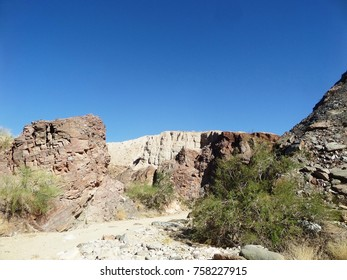 Trail leading through colorful rocks in the desert near Mecca, CA