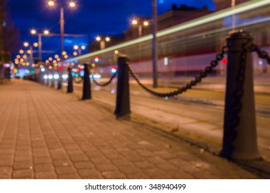 Trail of light left by tram, night city blurred image