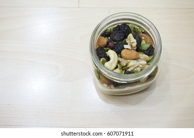 Trail Mixes on Wooden Background