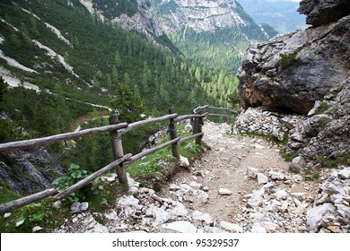 Trail in the mountains with a fence