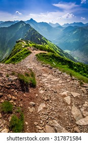 Trail in the mountains at sunny day