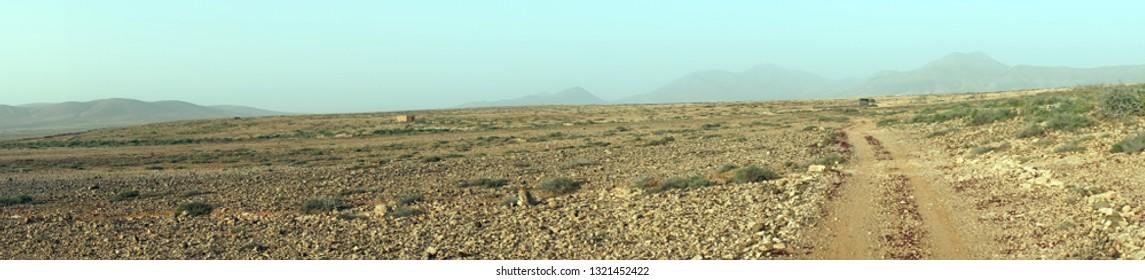 Trail on the arid land of Fuerteventura island, Spain