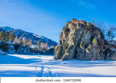 The trail on the frozen Katun river in Altai Mountains near Chemal village. Russian winter in Siberia.