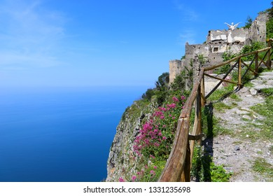 A trail on a hill in Maratea with a breathtaking view of the Mediterranean Sea and the Statue of Christ the Redeemer of Maratea in the distance
