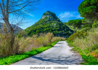 The trail, the pedestrian, in the valley of the Alcabrichel River and cane thickets along a banks, surrounded by evergreen trees on steep hills. Beautiful landscape near Vimeiro in Portugal.