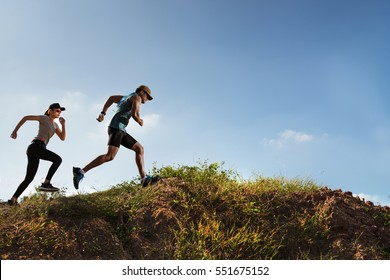 Trail Runner of men and women running on the mountain