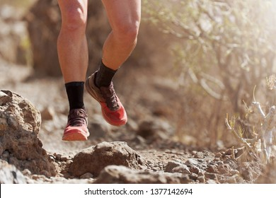 Trail running action close up of running shoes in action