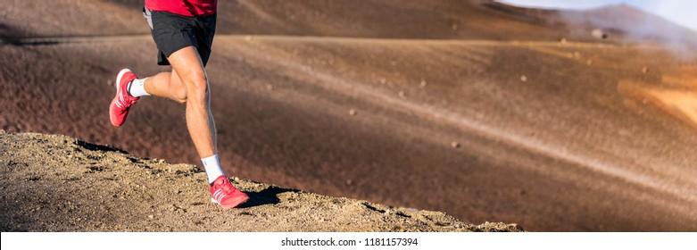 Trail running runner man on endurance run on volcano mountain. Ultra marathon race athlete on volcanic rocks path in mountains landscape.