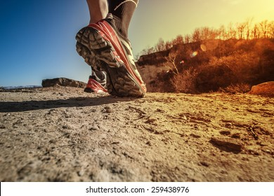 trail running shoes at the sunset