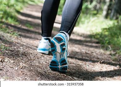 Trail running or trail walking woman