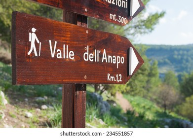 Trail signs inside the Calcinara valley in the north side of the  rocky necropolis of Pantalica