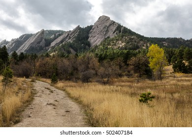 Trail view of the Flat Irons Mountains in Chataqua Park in Boulder, Colorado