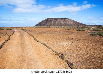Trail and volcano La Caldera on the small island of Lobos or Wolves Island, two kilometres north of the island of Fuerteventura, in the Canary Islands, Spain.