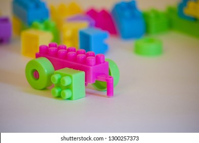 trailer from a children's plastic constructor with a square wheel. error and misconception concept