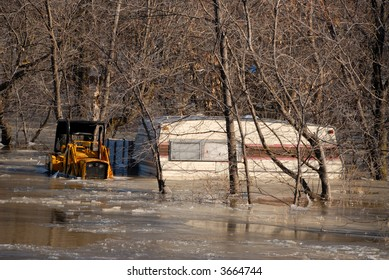trailer and machinery caught in a frozen flood