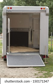 Trailer van to transport horses before loading the horses. Rear view.