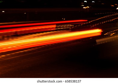 Trails of the car lights on night road