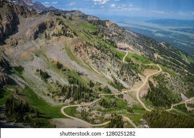 Trails and dirt roads through the Grand Tetons mountains in Jackson Hole Wyoming during the summer. Aerial view