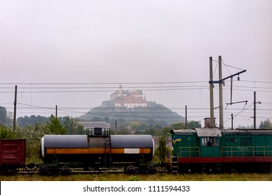 Train against the background of Palanok Castle in Mukacheve