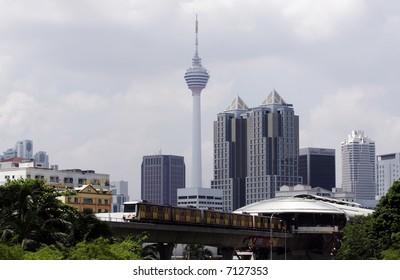 Train against Kuala Lumpur skyline