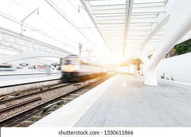 Train arrives at a white minimal station