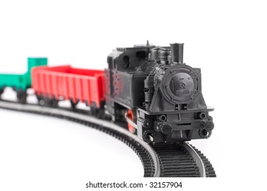 Train arriving: old toy railroad isolated