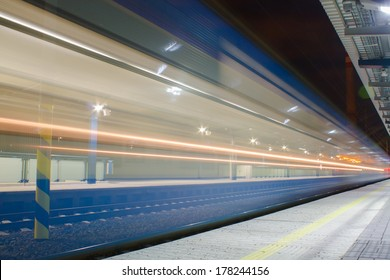 Train arriving to railway station in night