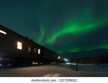train and aurora borealis over the tundra, Russia