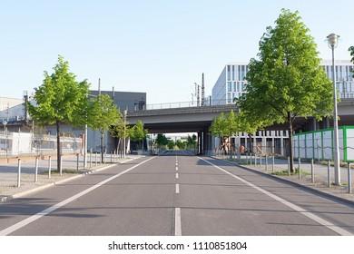 Train bridge across an empty street on a sunny afternoon, in downtown Berlin