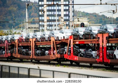 Train carrying cars.