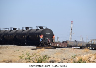 A train carrying petroleum tanks, two workers safeguard  the transportation of the tanks, Kern county, Bakersfield, CA, October 1, 2018.