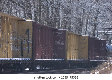 Train cars on a snowy day.