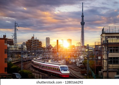 Train in city in Tokyo with sunset background, Tokyo, Japan. This immage can use for Transportation and travel concept in the city