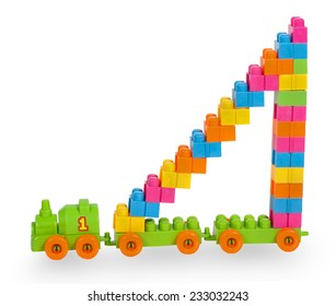 Train of colorful childrens building bricks with staircase isolated on white background