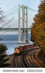Train coming around the tracks near the tacoma narrows bridges in washington state