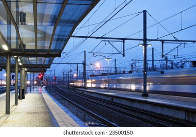 Train coming to the station in twilight (blurred)