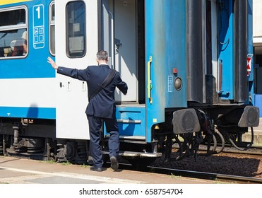 Train conductor at the station