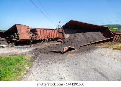 Train crash accident, road block. Mechanical problems and track conditions are to blame for a train derailment. Abstract: Transportation Safety