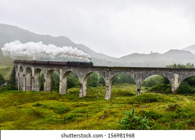 Train crossing the Glenfinnan Viaduct, Scotland, UK