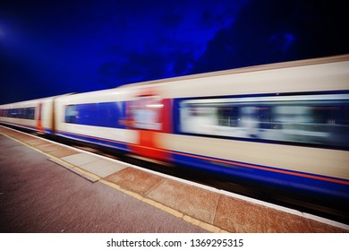 Train departing a UK station