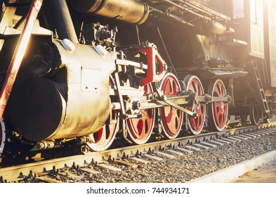 Train drive mechanism and red wheels of an old soviet steam locomotive.