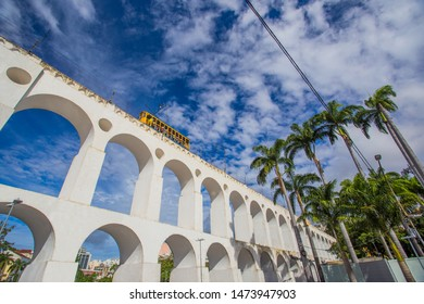 Train drives along distinctive white arches of the landmark Lapa Arches in Rio de Janeiro, Brazil - is a favorite place for tourists from all over the world. Fascinating and wonderful Rio De Janeiro