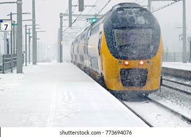 Train driving in snowstorm in winter in Amsterdam the Netherlands