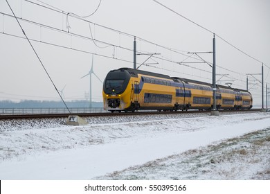 Train in Dutch rural winter landscape