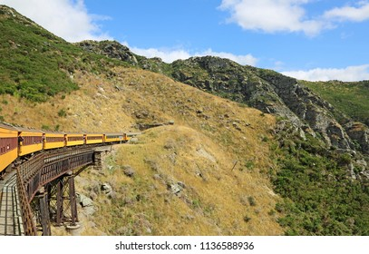 Train entering a tunnel - Taieri Gorge, south island, New Zealand