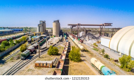 Train freight cars. Railway composition, export and import goods, pebbles of trucks with cement, with transportation of railways with fuel and coal cars from the factory